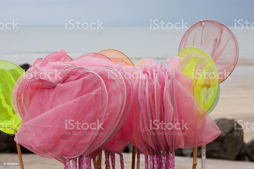 Children's shrimping nets for sale at the seaside UK stock photo