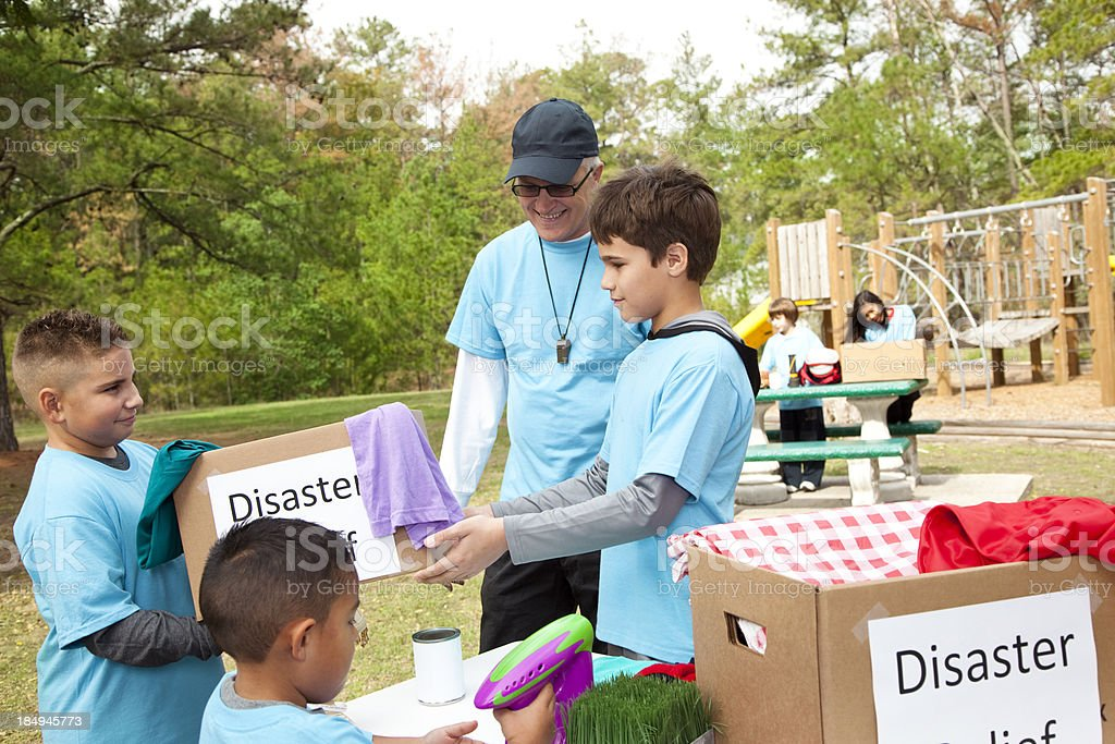 Children's sports team collect donations for disaster relief. Volunteers. stock photo
