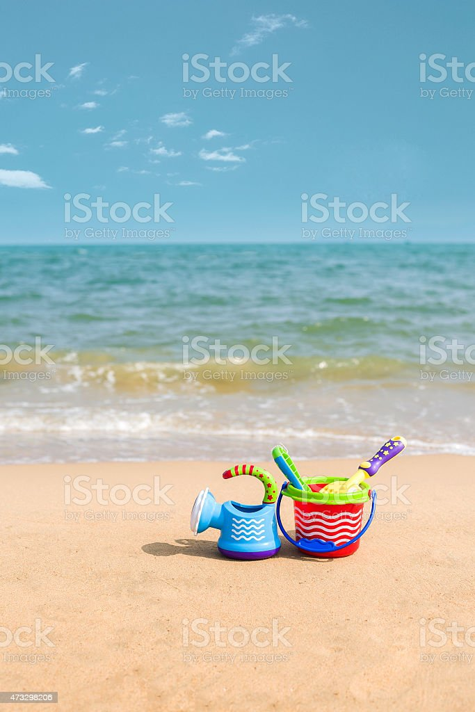 children's toys and conch on Beach stock photo