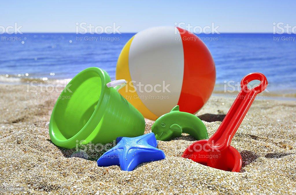 Children's toys on the beach stock photo