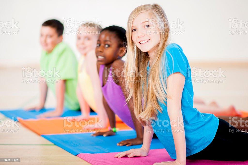 Childrens Upward Dog Yoga stock photo