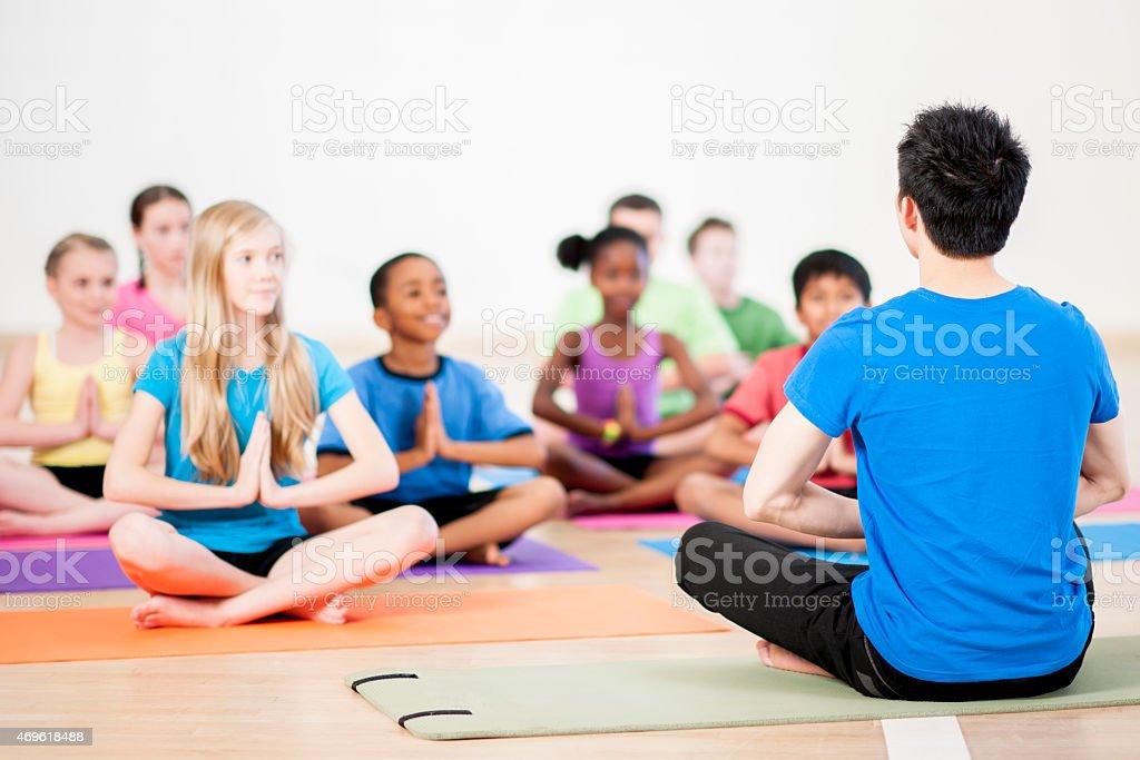 Childrens Yoga Class stock photo