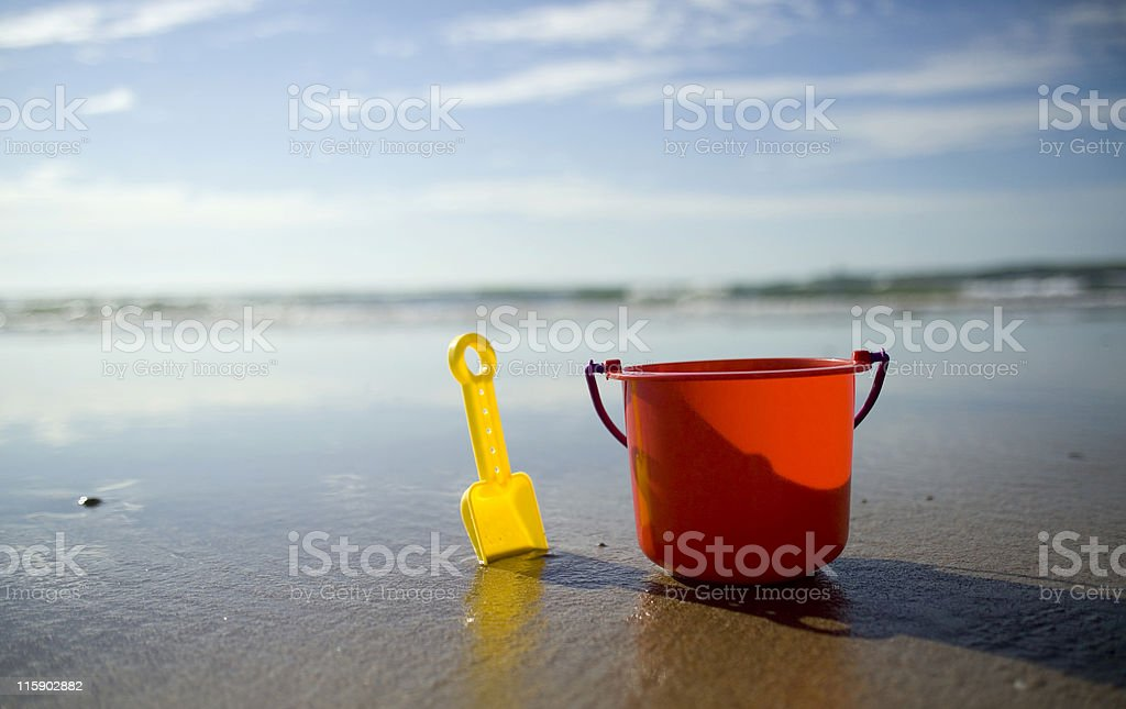 Childs bucket and spade in the early morning royalty-free stock photo