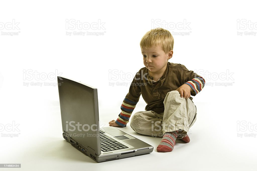 Childs Early Computer Skills using laptop on white background royalty-free stock photo