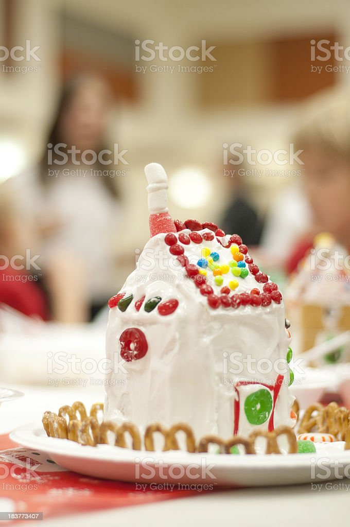 Child's gingerbread house at children's Christmas party royalty-free stock photo