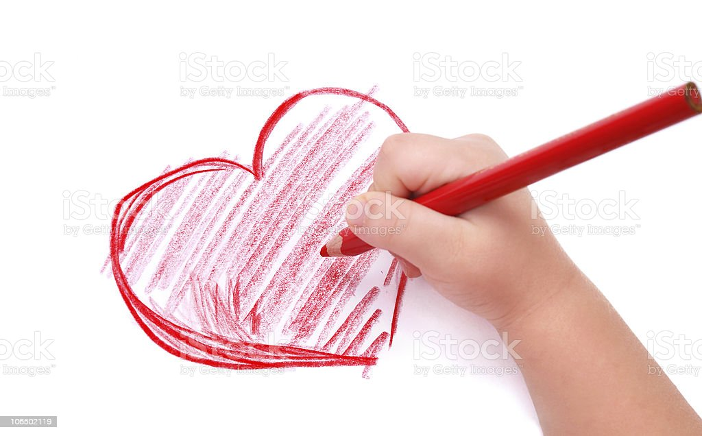 Childs hand drawing a red heart in pencil stock photo