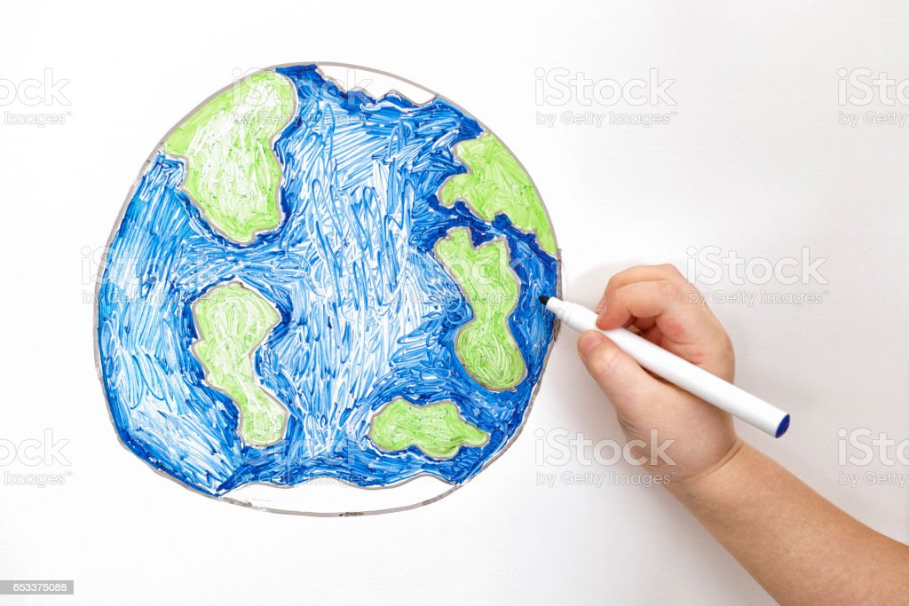 Child's hand drawing planet Earth with a marker stock photo