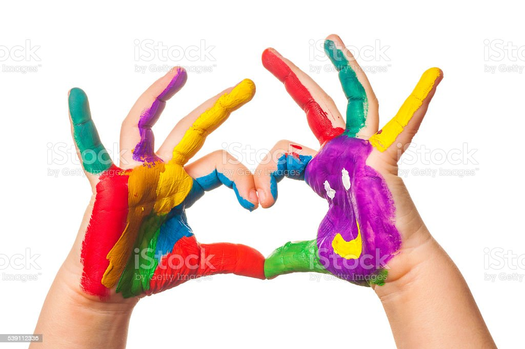 Child's hand painted watercolor in heart shape against white background stock photo