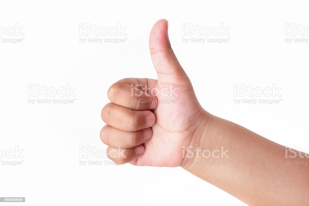 Child's hand showing thumb up, like, isolated on a white background stock photo