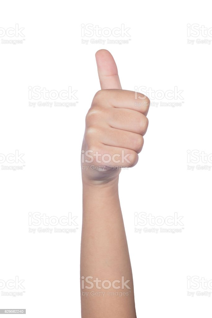 Child's hand showing thumb up stock photo