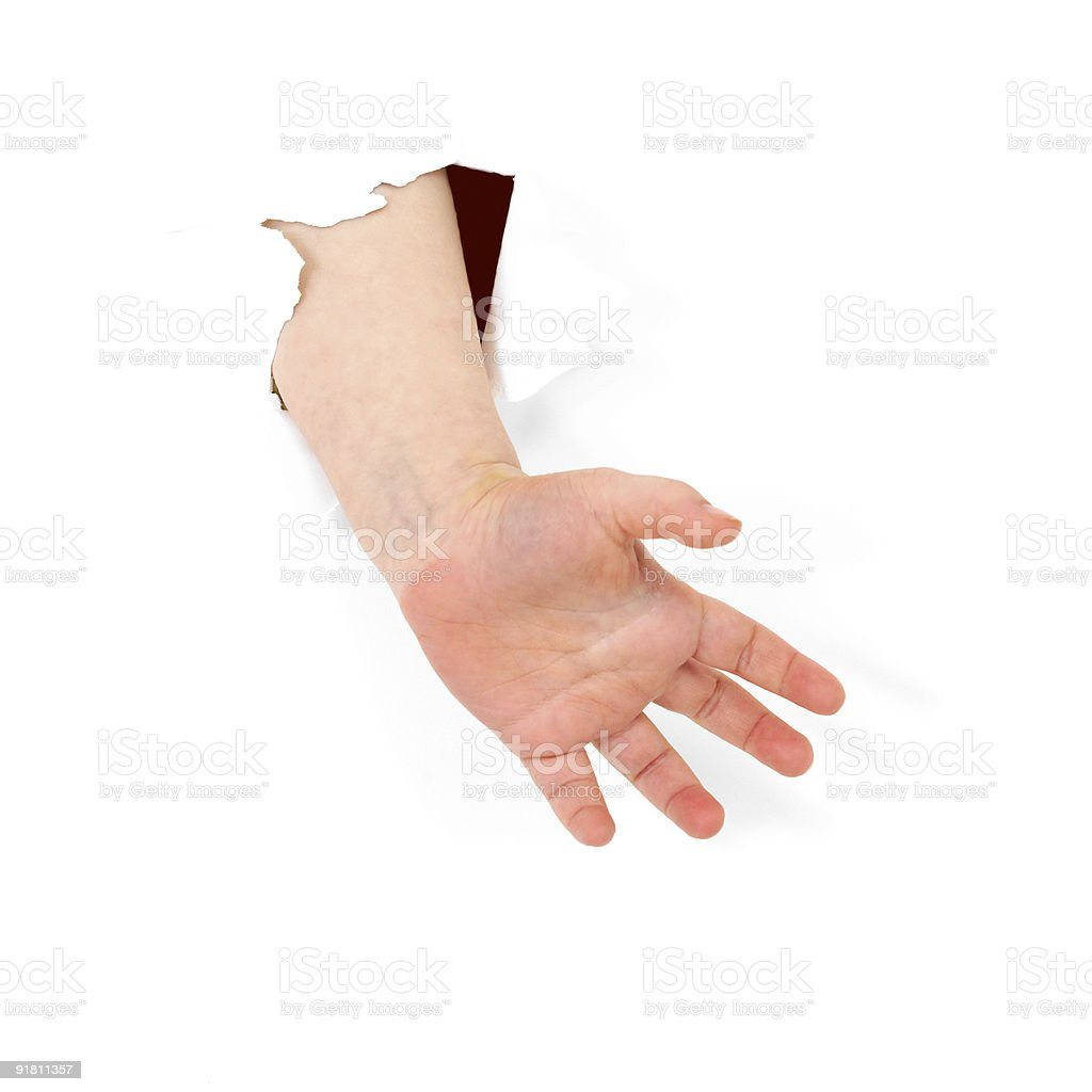 Child's hand stick out from hole royalty-free stock photo
