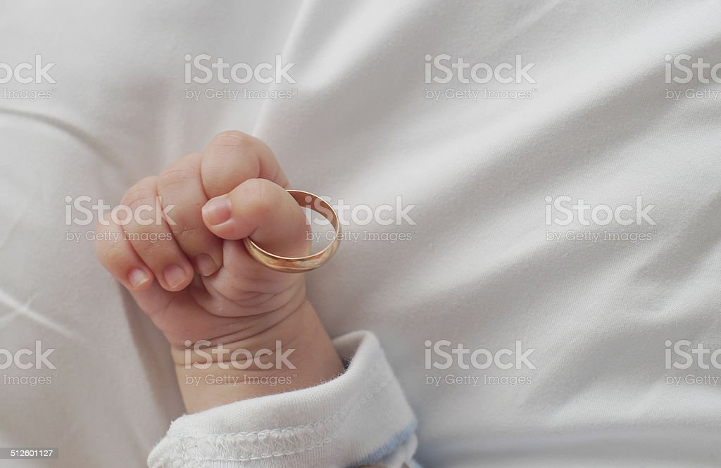 child's hand with a ring stock photo