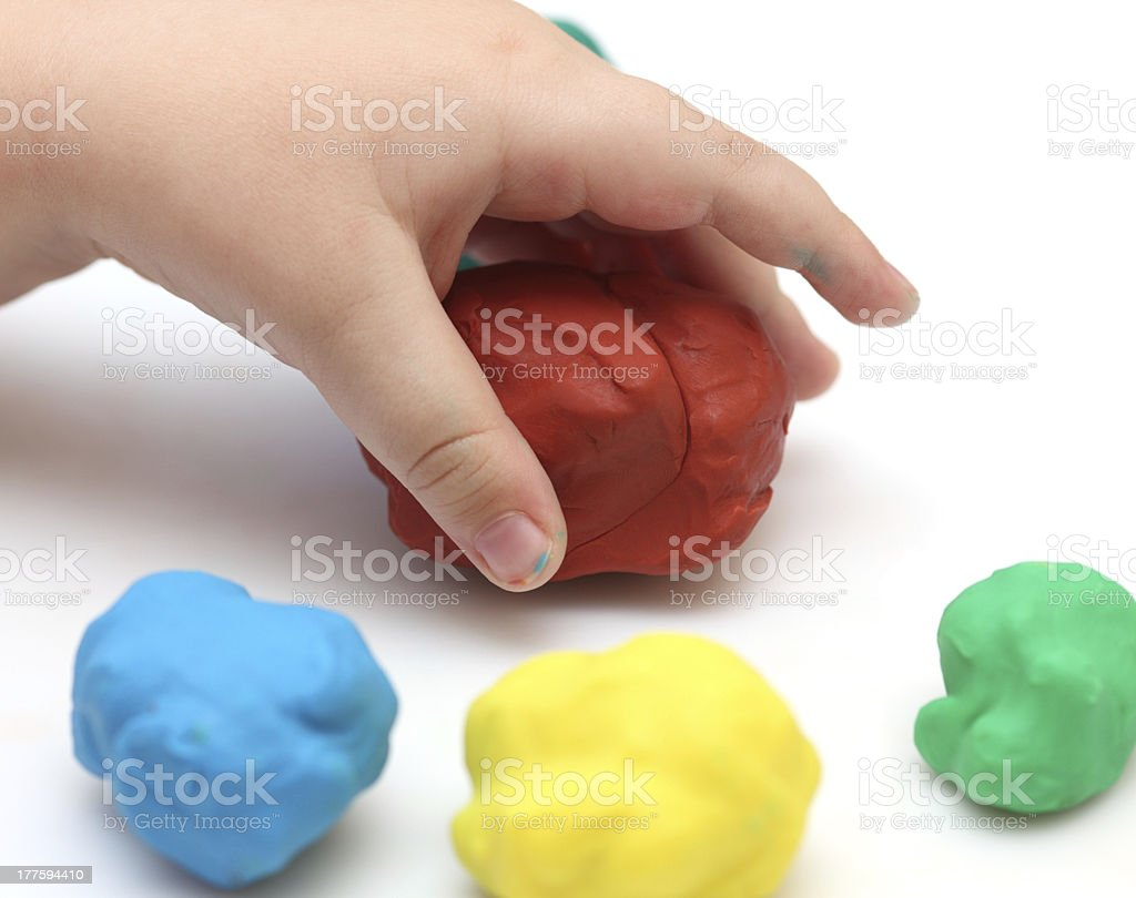 Child's hand with playdough stock photo