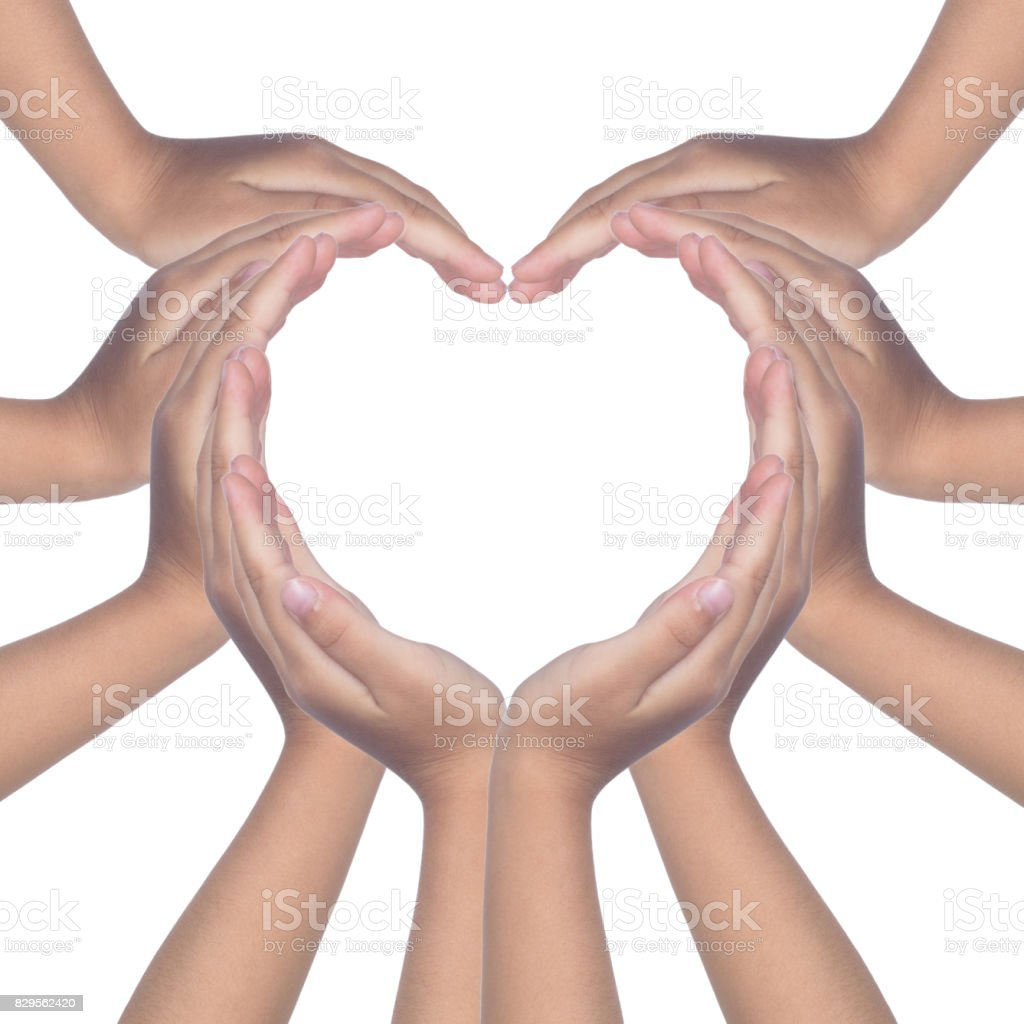 Child's hands making a heart shaped stock photo