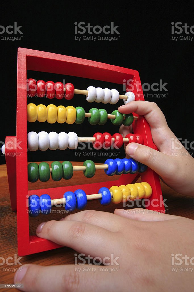 Childs hands on an abacus royalty-free stock photo