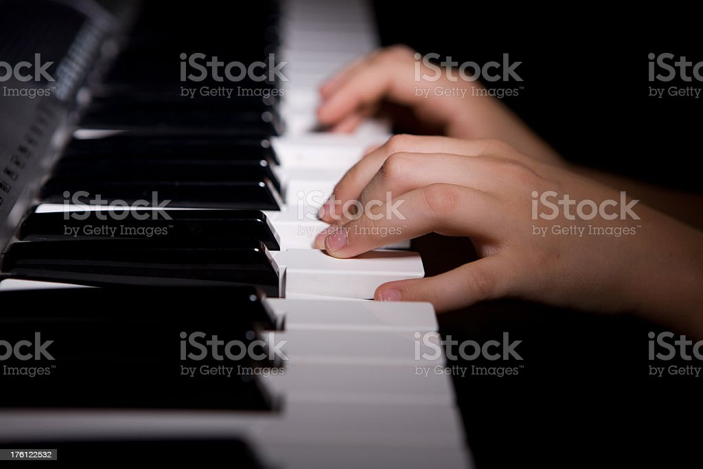 Child's hands playing piano - horizontal royalty-free stock photo