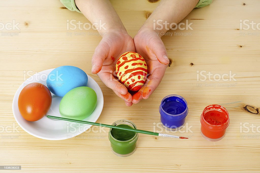 Child's hands with easter eggs royalty-free stock photo