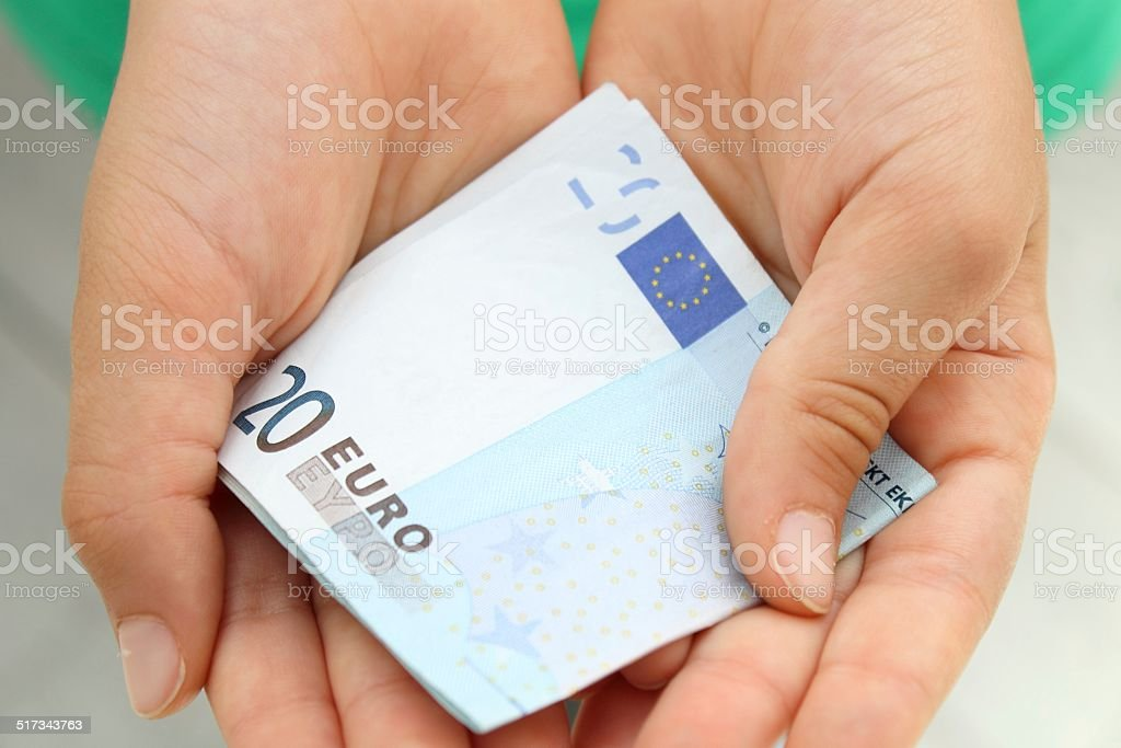 Child's hands  with money stock photo