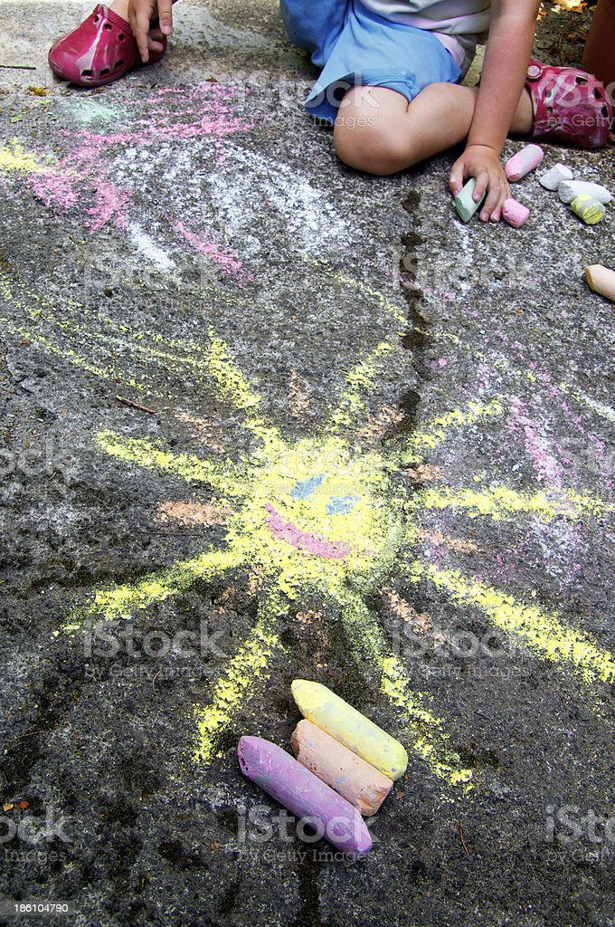 Childs painting on the pavement stock photo