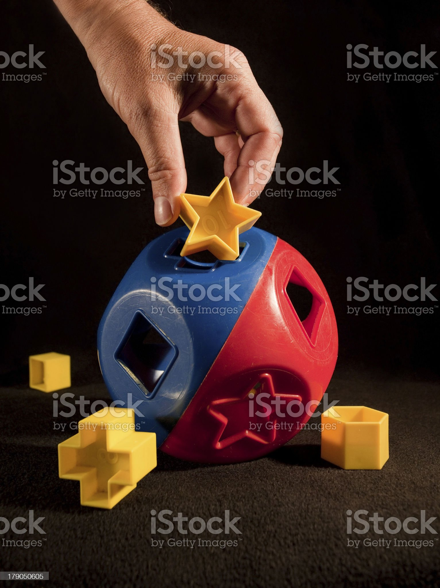 Child's puzzle with different shaped holes royalty-free stock photo