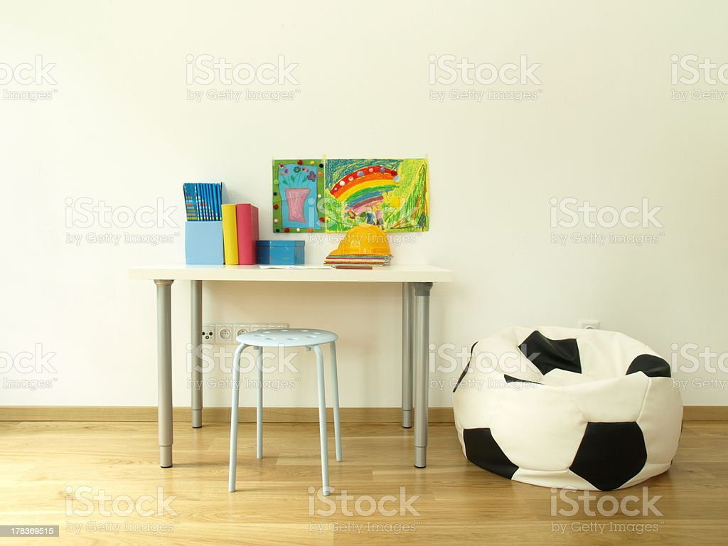 Child's room with a soccer ball bean bag royalty-free stock photo