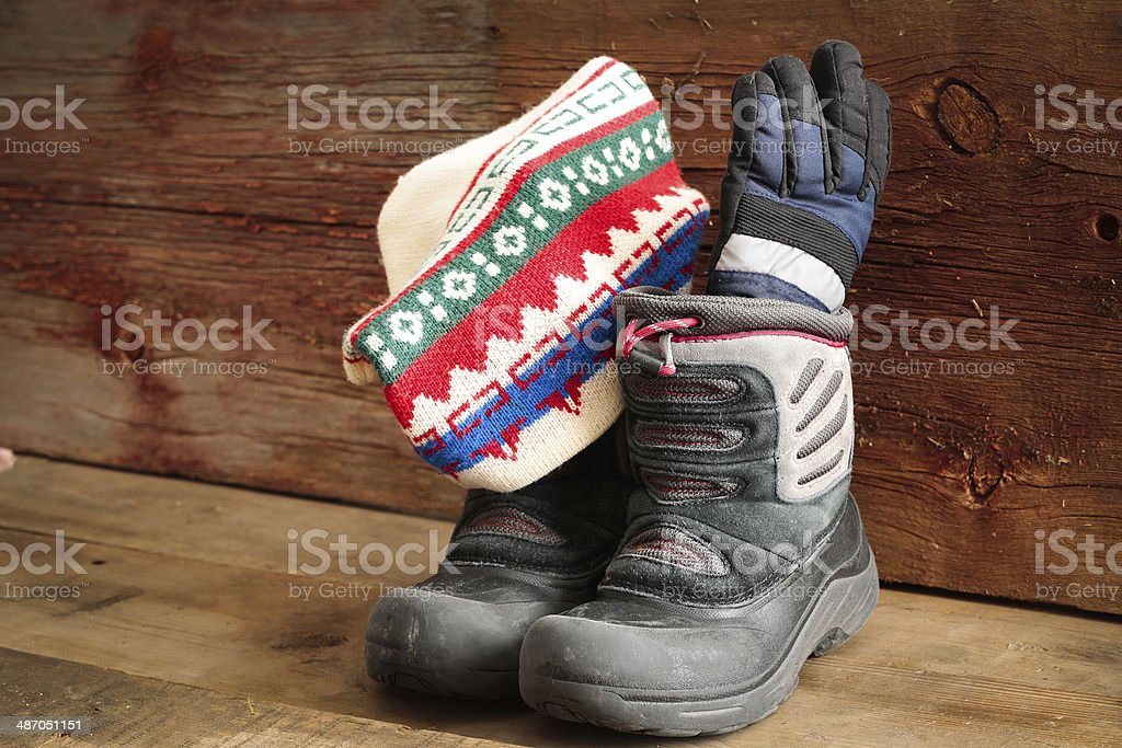 Childs snow boots with a winter cap and gloves stock photo