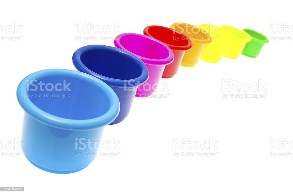 childs toy stacking cups isolated on white background royalty-free stock photo