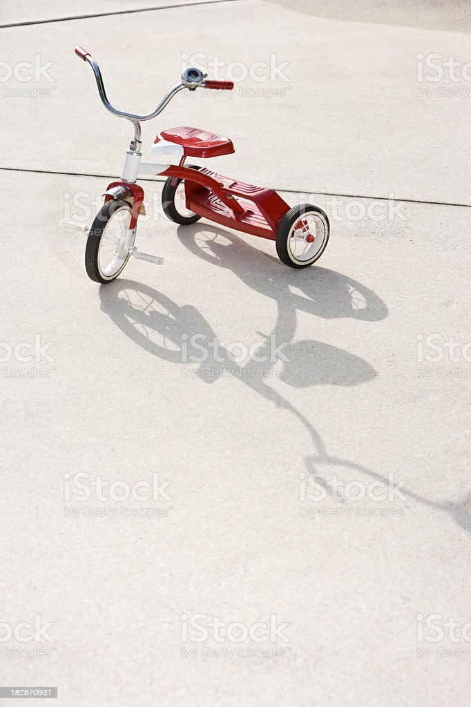 Child's tricycle on driveway stock photo