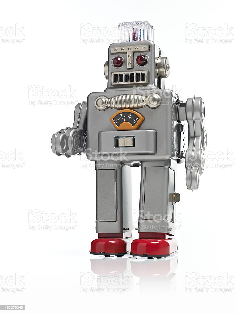 Childs Walking retro Robot toy isolated on a white background stock photo