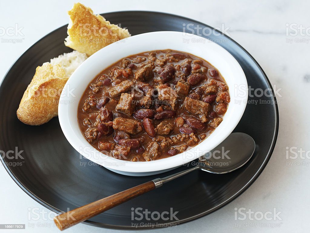 Chile con carne served with bread stock photo