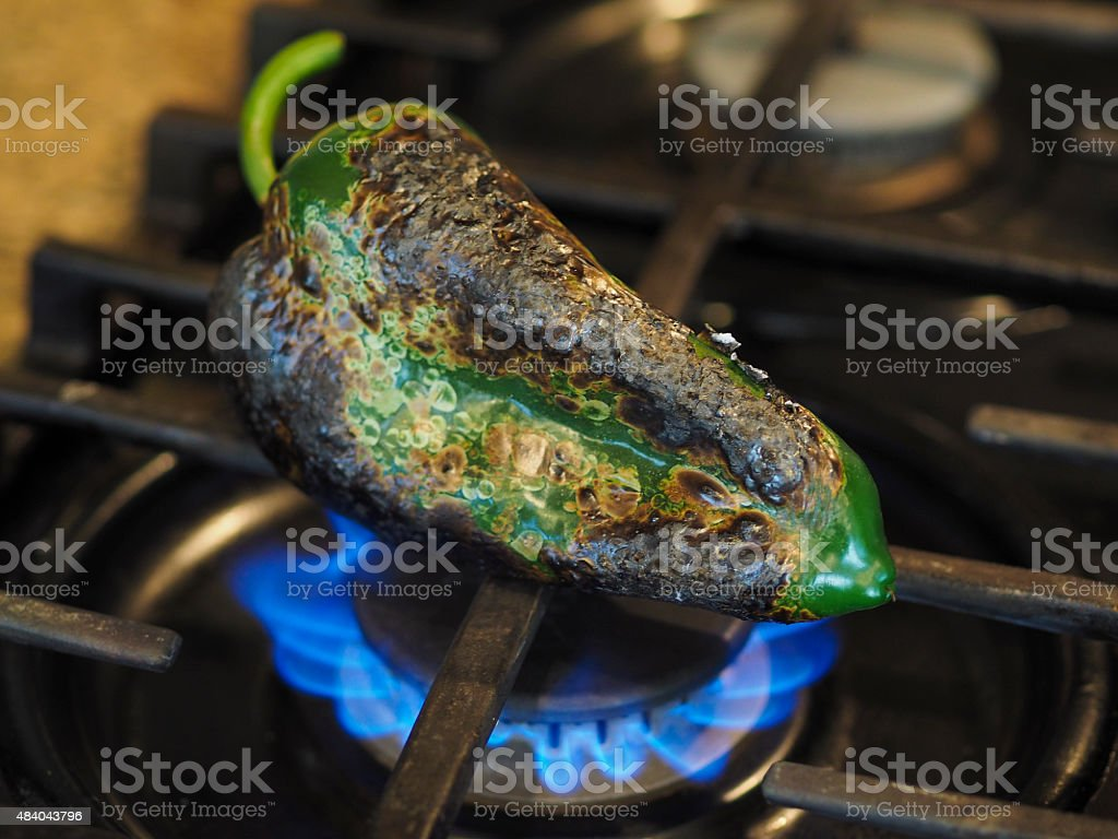 Chile Roasting on open burner stock photo