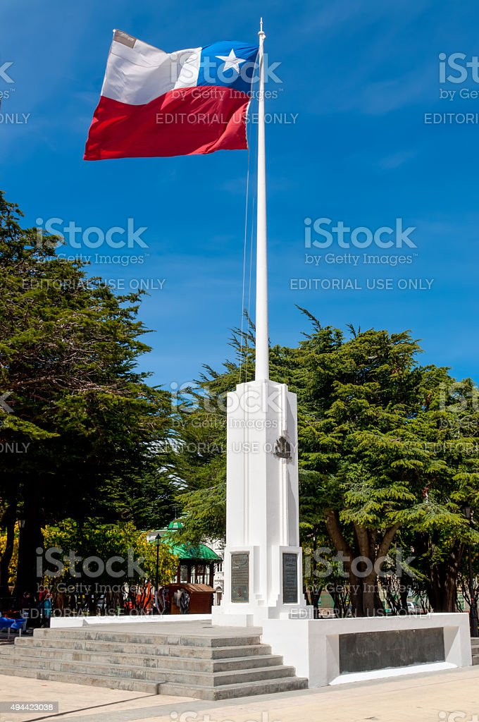 Chilean flag whipping in the wind at a memorial stock photo