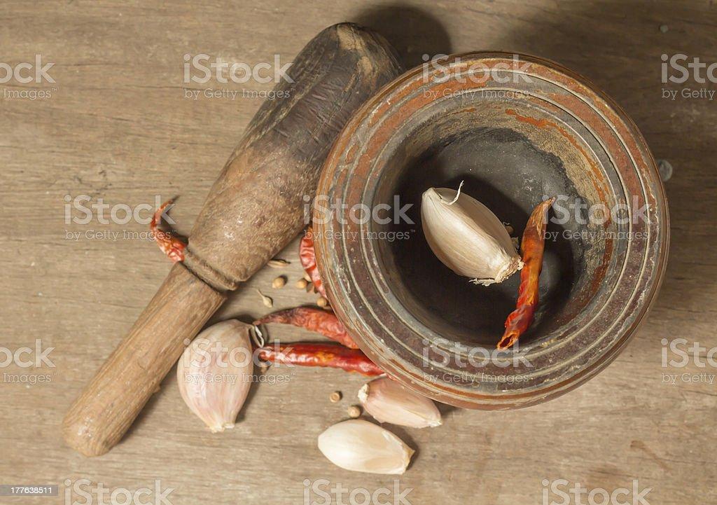 Chili and garlic with mortar royalty-free stock photo