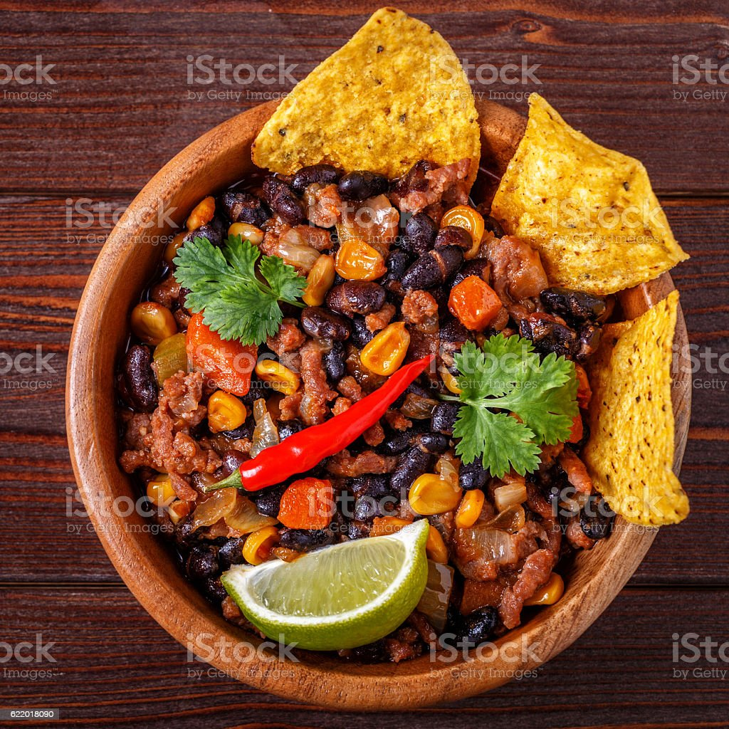 Chili con carne in bowl with tortilla chips. stock photo