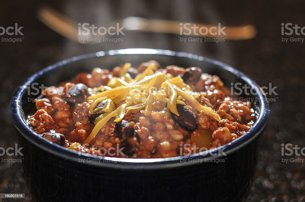 Chili con carne with cheese in a bowl stock photo
