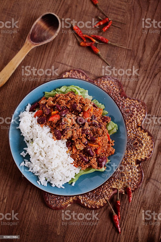 Chili Con Carne with rice and hot pepper stock photo