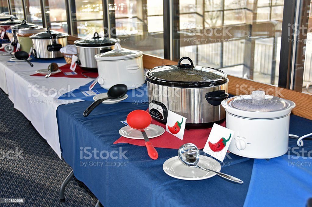chili cook off with crock pots stock photo