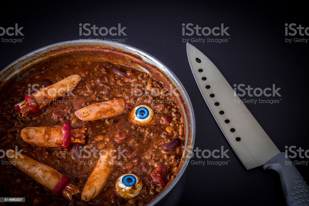 Chili cooking with fake human fingers and eyeballs stock photo