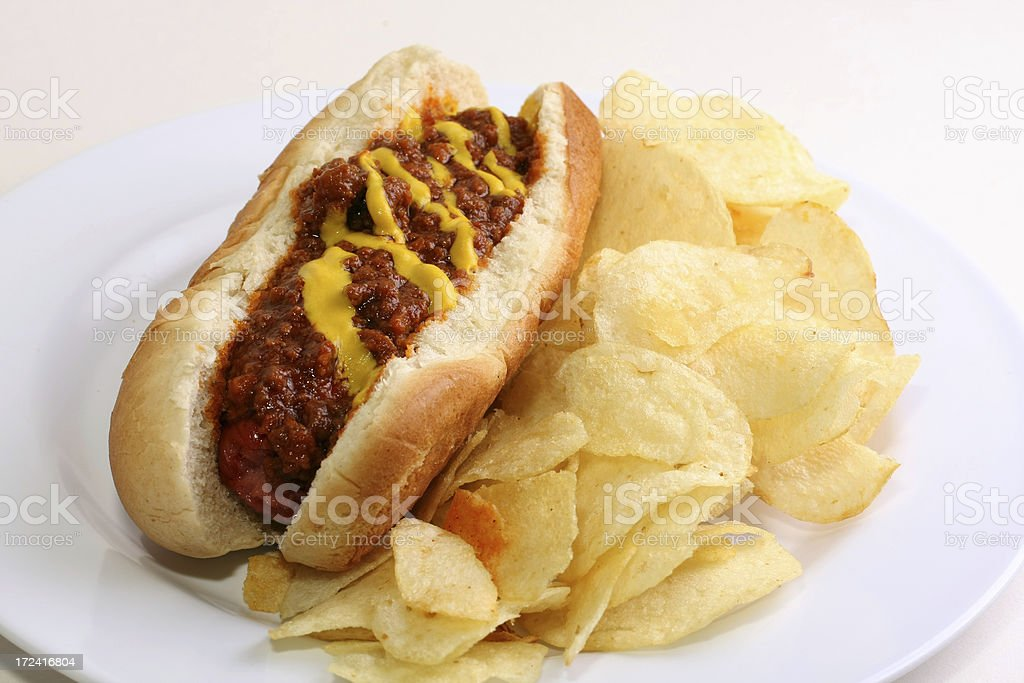 Chili Dog with potato chips stock photo