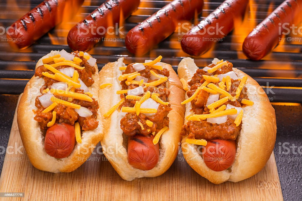 Chili Hot Dogs with Cheddar Cheese and Onions stock photo