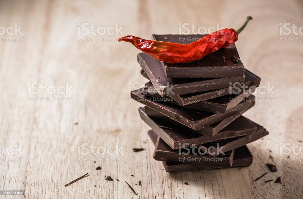 Chili on the stack of chocolate bars stock photo