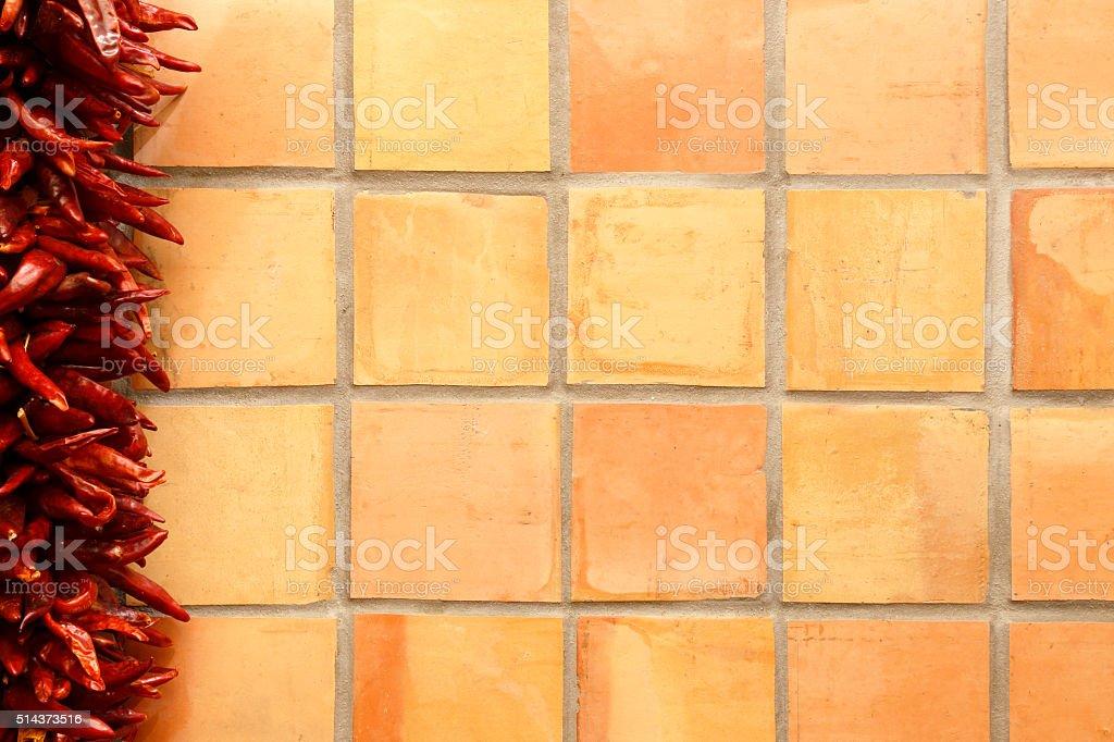 Chili Pepper Ristra On Saltillo Tile Background stock photo