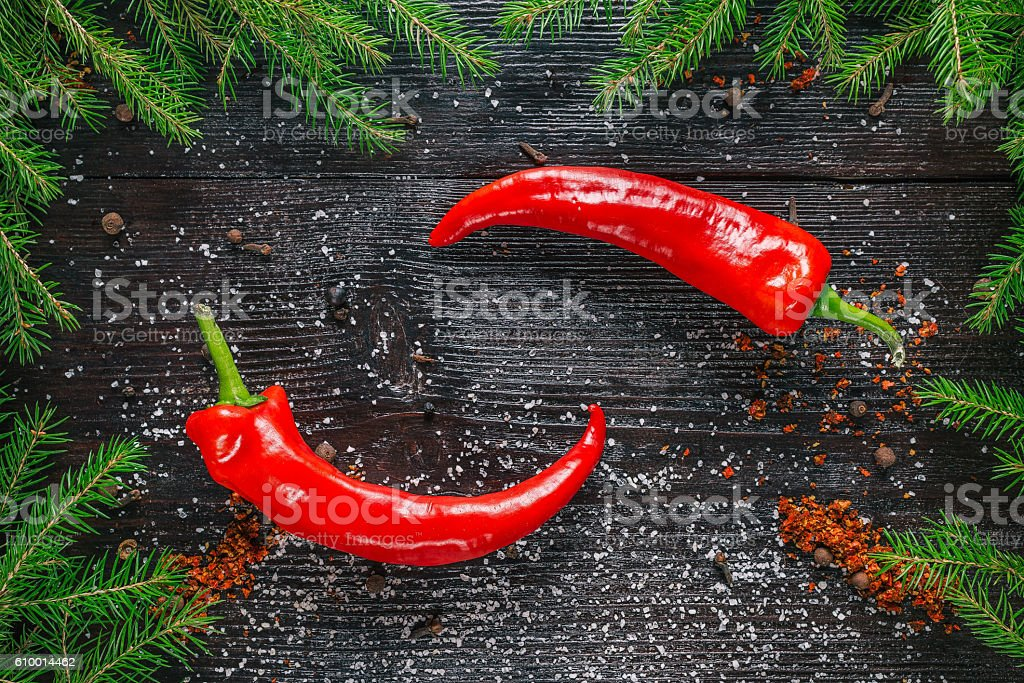 Chili peppers in christmas tree frame stock photo