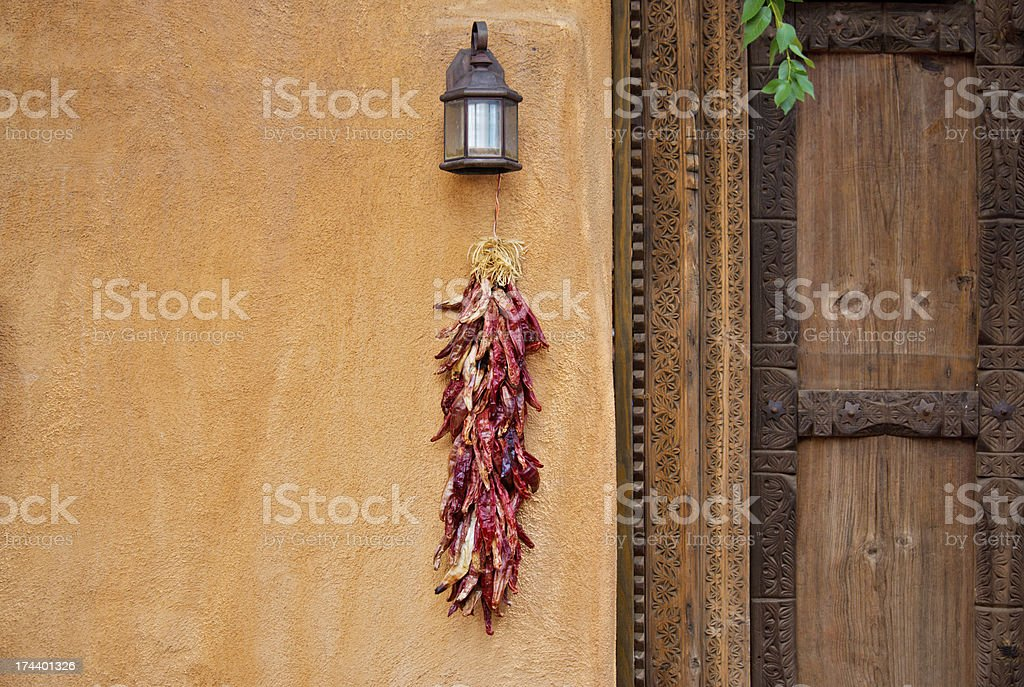 Chili Peppers Ristras on Adobe Wall royalty-free stock photo