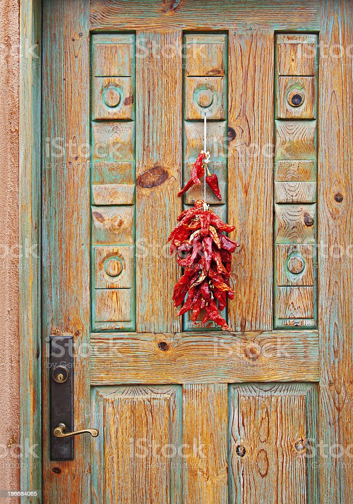 Chili Peppers Ristras on Santa Fe Wooden Carved Door stock photo