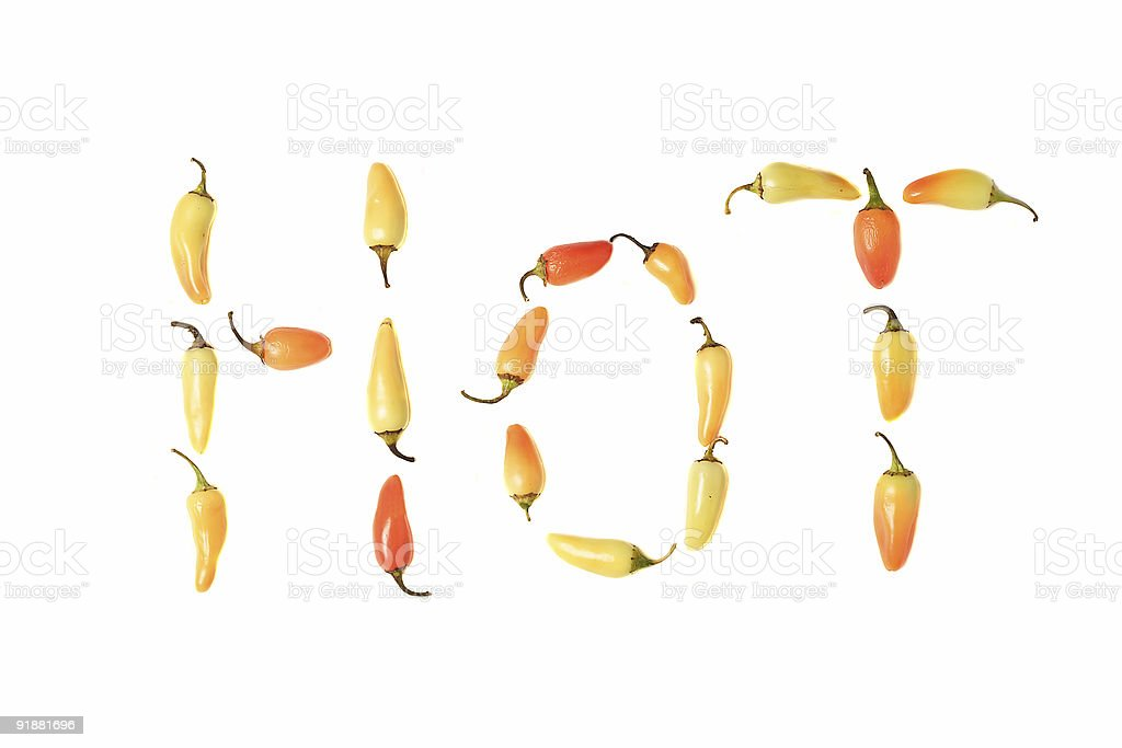 Chili Peppers Spelling out the word H O T royalty-free stock photo