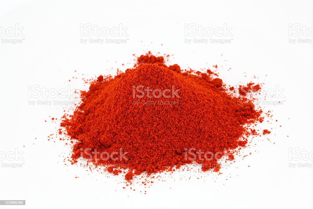 Chili powder heap on white royalty-free stock photo