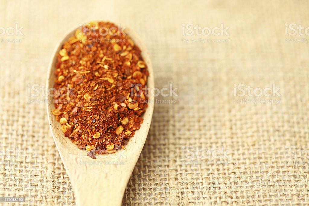Chili powder on wooden spoon royalty-free stock photo