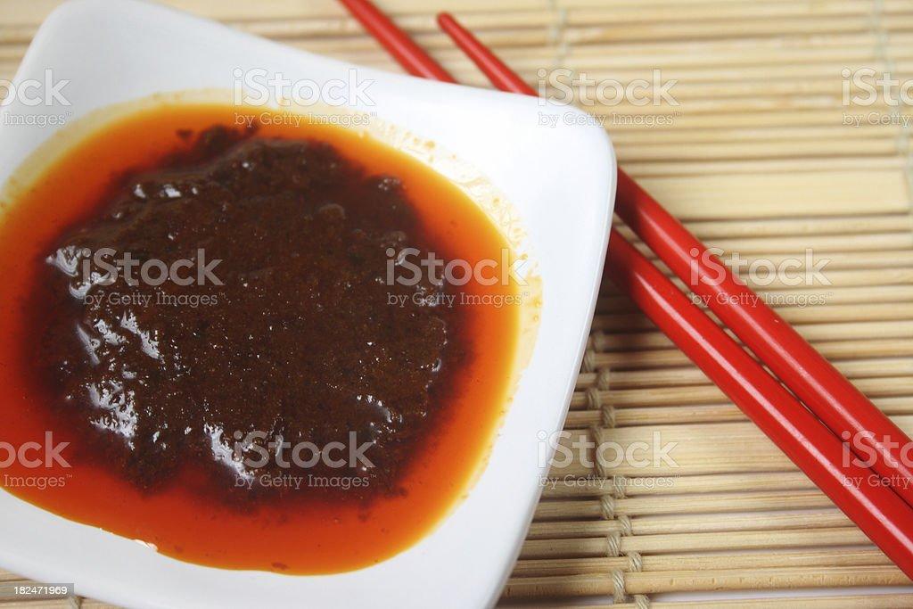 Chili Sauce and chopsticks royalty-free stock photo