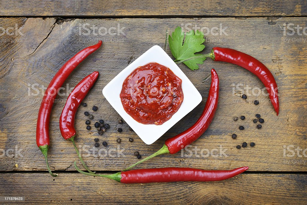 Chili Sauce on a wooden board stock photo